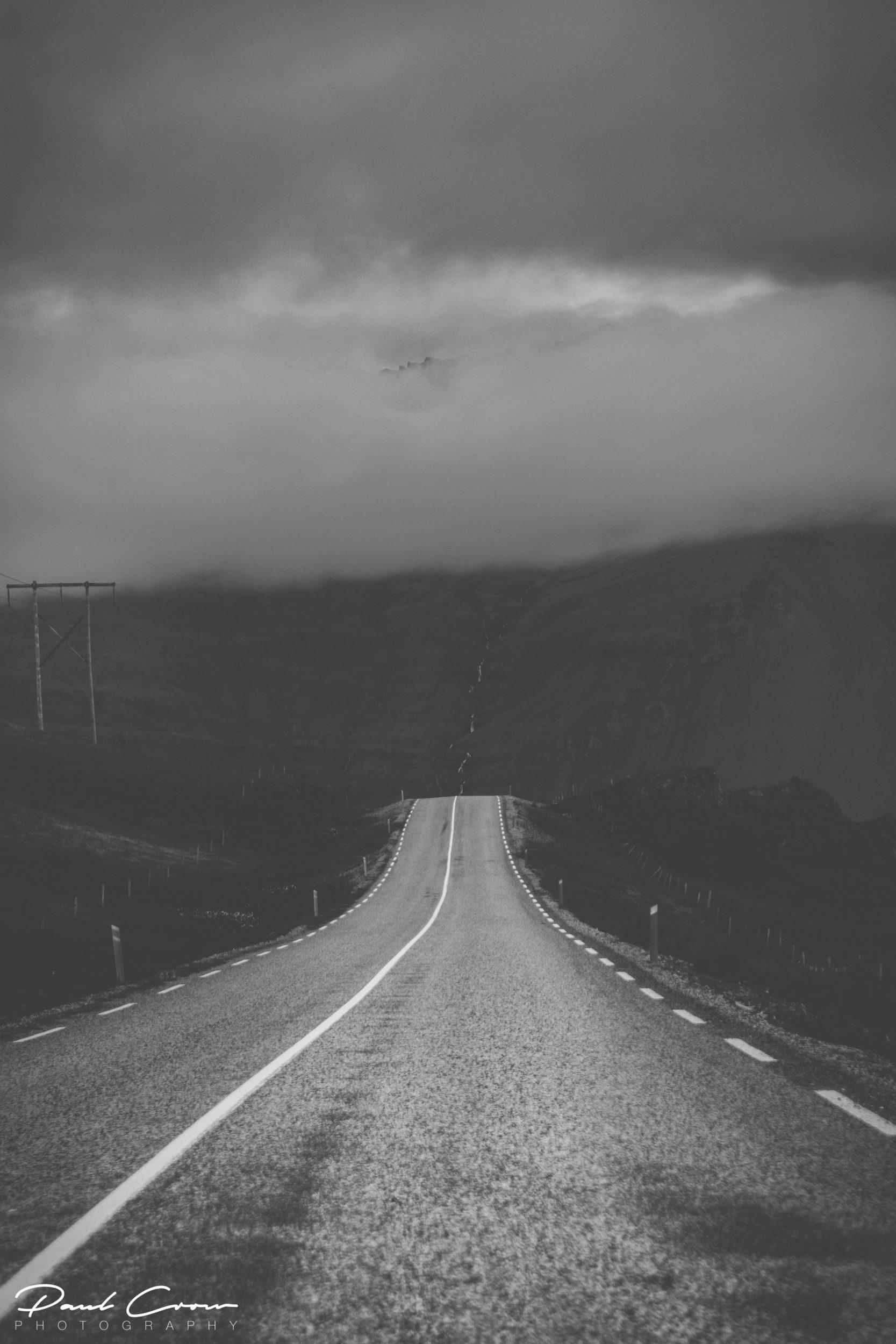 Road under the clouds to Stöðvarfjörður