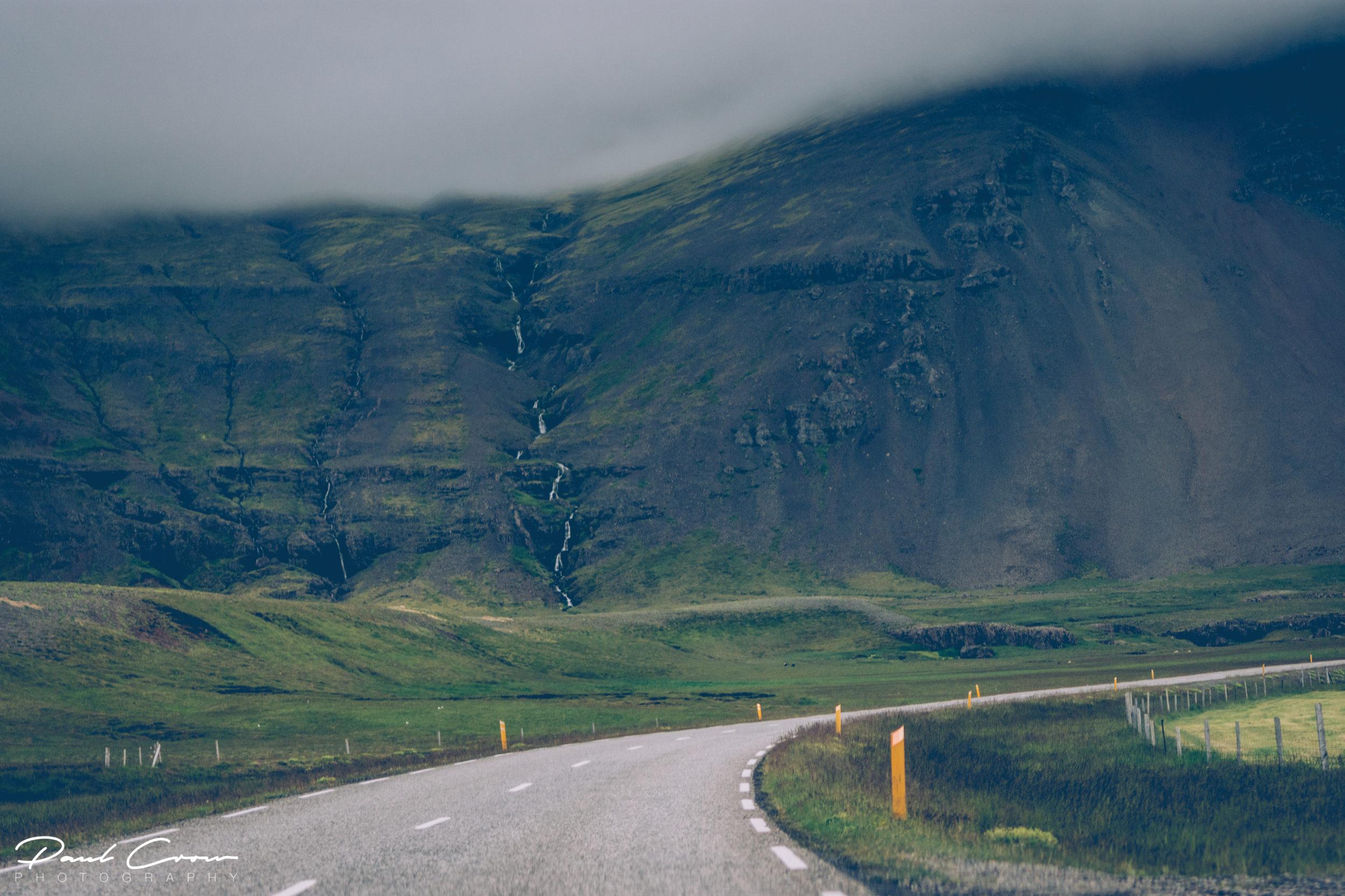 Stöðvarfjörður curved with clouds roads